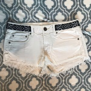 AE  cutoff white jeans with black beading